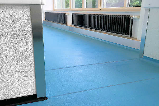 Epoxy resin floor with anti-slip coating in catering kitchen