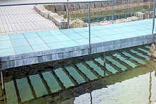 Glass bridge with non-slip coating