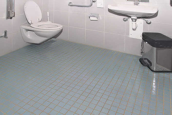 Toilet area with non-slip coating