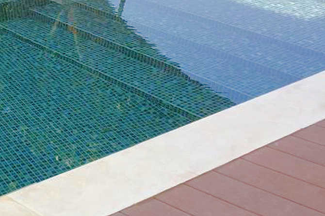Pool surround made of natural stone with SWISSGriP